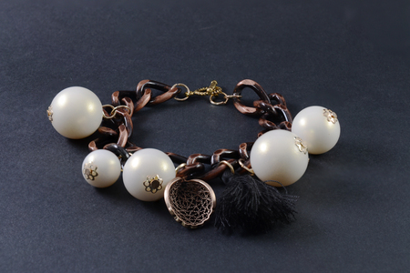 pendants: Bracelet with pendants isolated on black