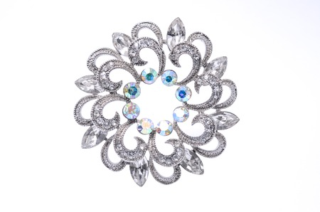 round brooch with gems isolated on white
