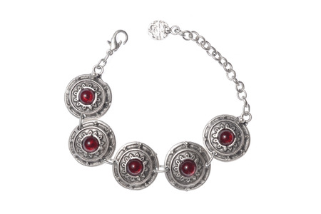 Silver bracelet with rubies on a white background