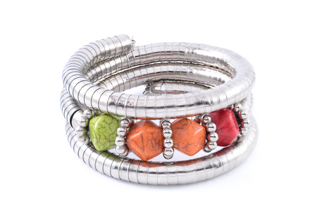 armlet: iron bracelet with colored stones isolated on white Stock Photo
