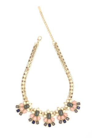 diamond shape: gold necklace with pink stones isolated on white Stock Photo