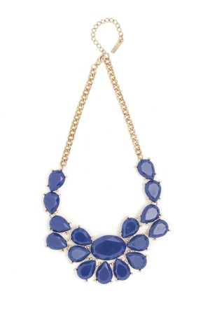 Gold necklace with blue stones isolated on white 스톡 콘텐츠