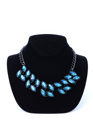 coulomb: necklace with blue stones on mannequin isolated on white