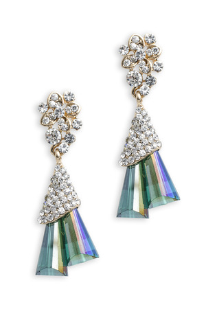 dearness: gold earrings with emeralds isolated on white Stock Photo