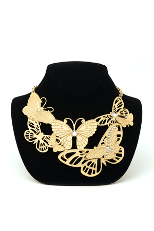 ornamentals: gold necklace with butterflies on a mannequin Stock Photo