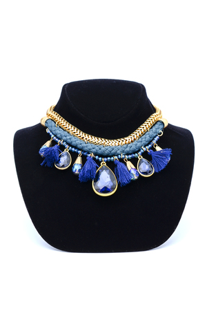 ornamentals: Necklace with precious stones and gold chain on a mannequin