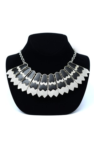 finery: Necklace on a black mannequin
