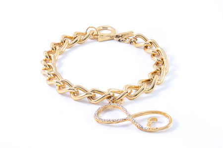 wristlet: thick gold bracelet isolated on white
