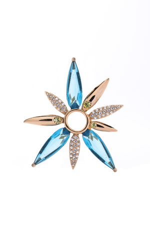 brooch: golden brooch with aquamarine and diamonds on white background Stock Photo