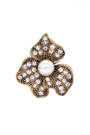 broach: brooch in the shape of a flower with a pearl on a white background