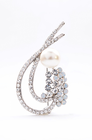 brooch with pearl on a white background Standard-Bild