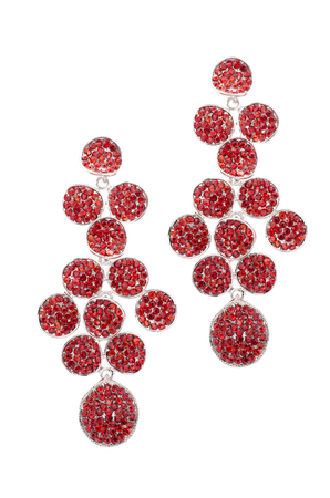 dearness: red earrings inlaid with precious stones on a white background Stock Photo