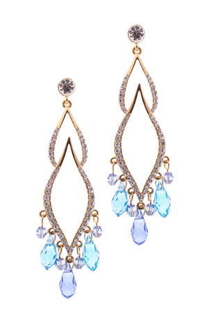 inlaid: earrings inlaid with precious stones on a white background Stock Photo
