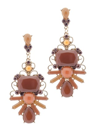 sumptuousness: earrings inlaid with precious stones on a white background Stock Photo