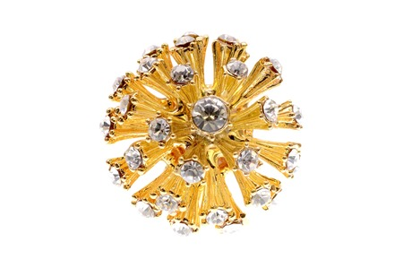 lap of luxury: brooch in the form of the sun on a white background