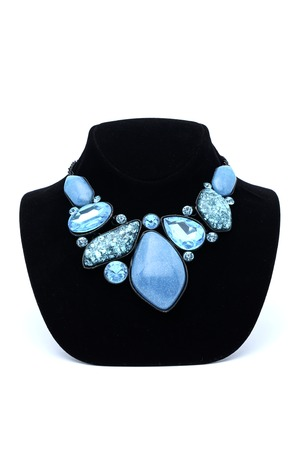 Necklace with blue gems on a mannequin Фото со стока