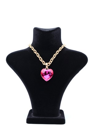 coulomb: Pendant with pink heart on a mannequin isolated on white
