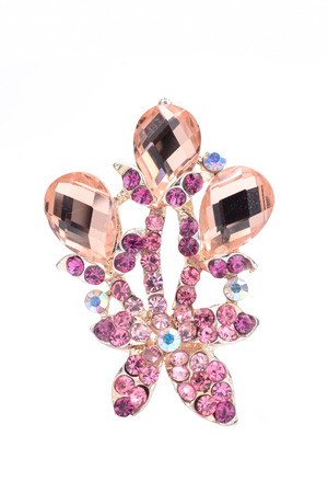 broach: brooch with pink flower isolated on white