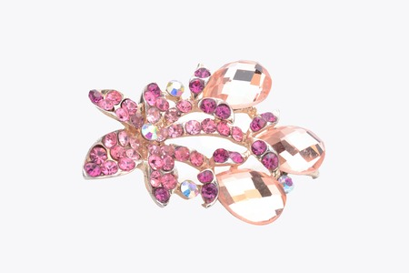 brooch: brooch with pink flower isolated on white