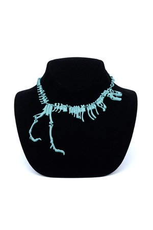 necklace with a dinosaur on a mannequin isolated on white