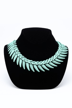 ladies bust: turquoise necklace on a mannequin Stock Photo