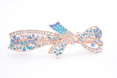 broach: brooch with a bow of Gems isolated on white