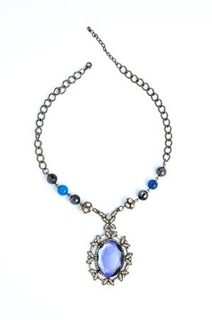 pietre preziose: pendant with precious stones on a white background