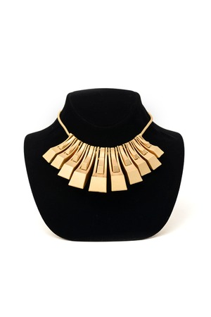ladies bust: unusual gold necklace on a mannequin