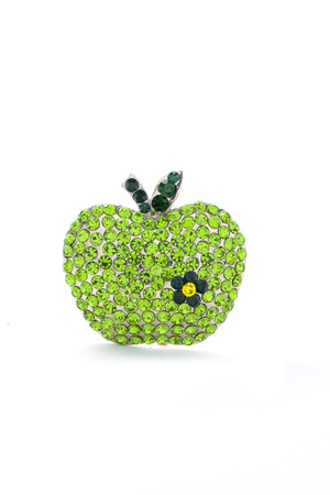 luxe: green apple  brooch on a white background Stock Photo