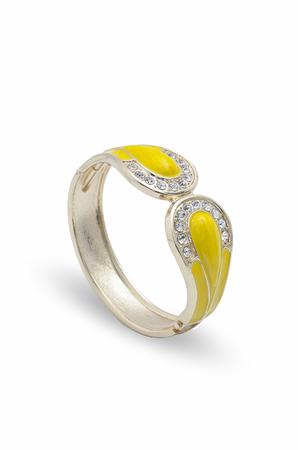 wristlet: yellow bracelet with diamonds on a white background