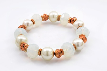 pretty s shiny: bracelet with pearls on a white background