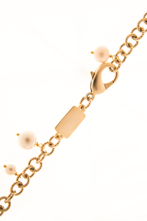 to clasp: gold clasp with beads on a white background