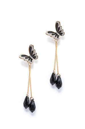dearness: earrings with black butterflies on a white background Stock Photo