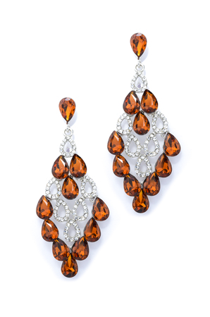 sumptuousness: amber earrings on a white background