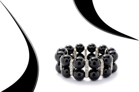 wristlet: Black bracelet with beads on a white background Stock Photo