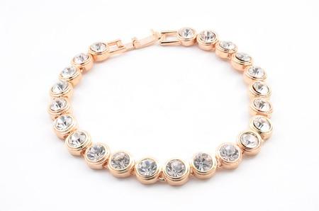 thin gold bracelet on a white background 版權商用圖片