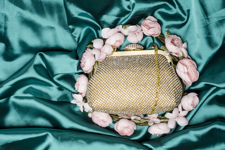 jewel case: gold clutch in flowers on green silk
