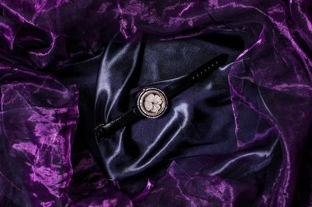 surfeit: jewelry wristwatch on silk