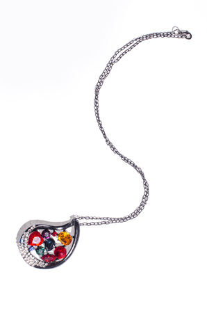 coulomb: black pendant with colored gems on a white background Stock Photo
