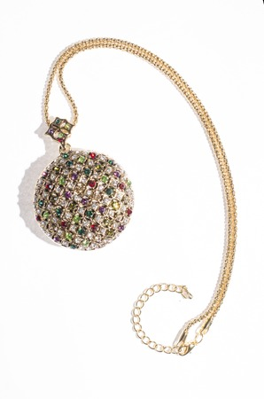 coulomb: gold pendant in the form of a pocket watch Stock Photo