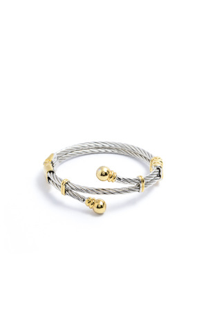 luxe: silver bracelet with gold accents on a white background