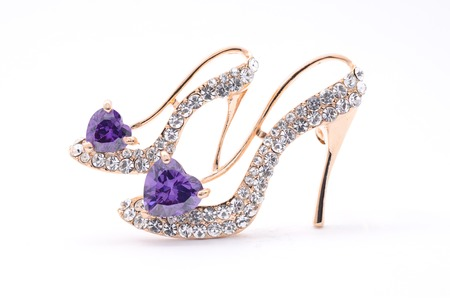 brooch in the form of shoes on a white background