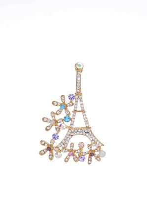 brooch: brooch Eiffel Tower on a white background