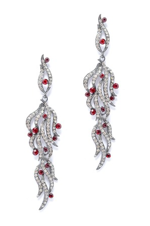 sumptuousness: silver earrings with red stones on white background