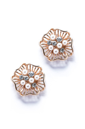dearness: gold earrings with pearls on white background