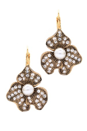 dearness: earrings with pearls on a white background