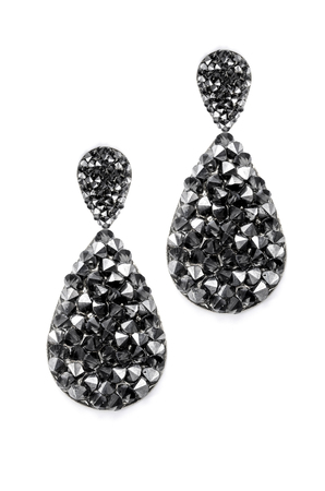 sumptuousness: black earrings droplets on a white background Stock Photo