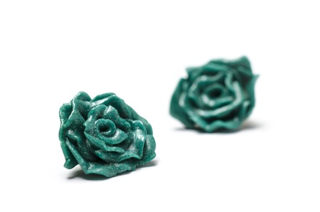 sumptuousness: two copper green earrings on a white background
