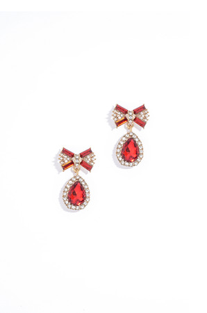 sumptuousness: ruby earrings on a white background