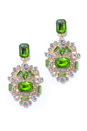 sumptuousness: emerald earrings on a white background